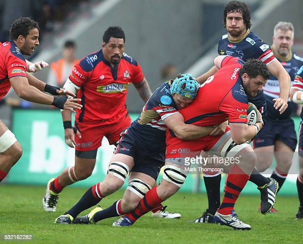 Alex Shaw of Doncaster Knights tackles James Phillips of Bristol Rugby during the Greene King IPA Championship Play Off Final match First Leg between...