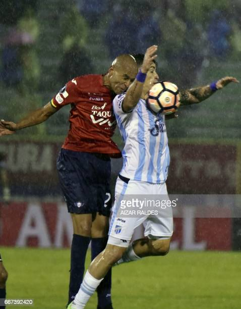Alex Silva of Bolivia's Wilstermann vies for the ball with Fernando Zampedri of Atletico Tucuman of Argentina during their Copa Libertadores football...