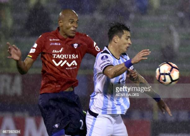 Alex Silva of Bolivia's Wilstermann vies for the ball with Fernando Zampedri Atletico Tucuman of Argentina during their Copa Libertadores football...