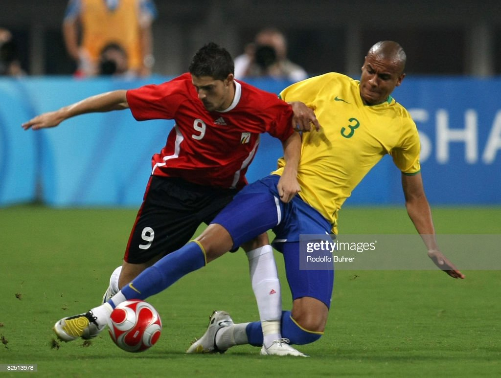 Alex Silva of Brazil and Vincent Kompany of Belgium compete for the ball during the Bronze Medal Match between Belgium and Brazil at Shanghai Stadium on Day 14 of the Beijing 2008 Olympic Games on August 22, 2008 in Shanghai, China.