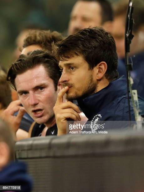 Alex Silvagni of the Blues is seen injured on the bench during the 2017 AFL round 12 match between the Carlton Blues and the GWS Giants at Etihad...
