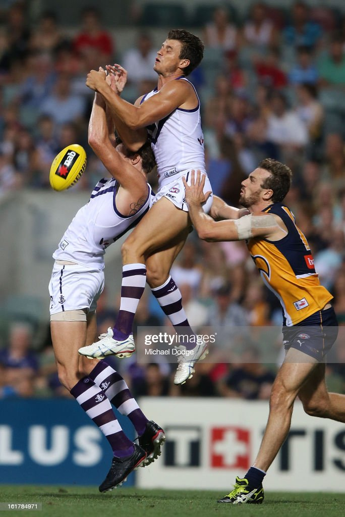 Alex Silvagni of the Fremantle Dockers spoils teamate Jonathon Griffin (L) during the round one NAB Cup match between the West Coast Eagles and the Fremantle Dockers at Patersons Stadium on February 16, 2013 in Perth, Australia.