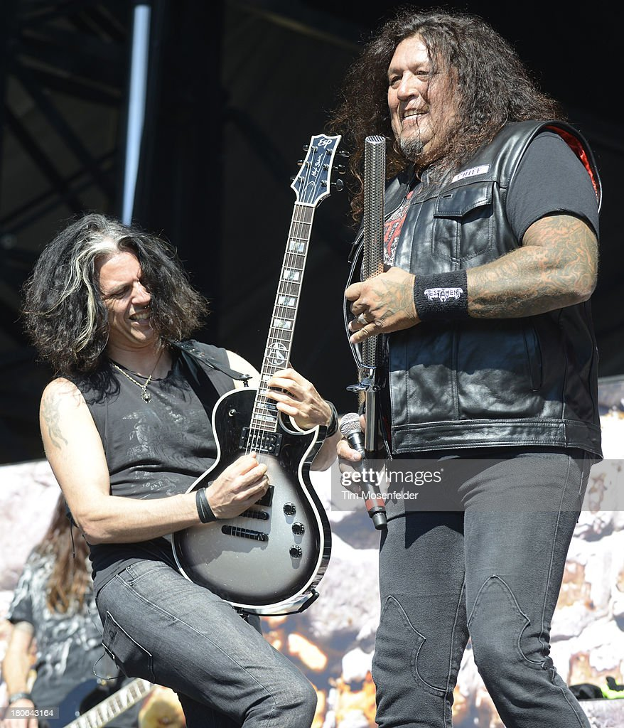 Alex Skolnick (L) and Chuck Billy of Testament perform as part of the Aftershock Music Festival at Discovery Park on September 14, 2013 in Sacramento, California.