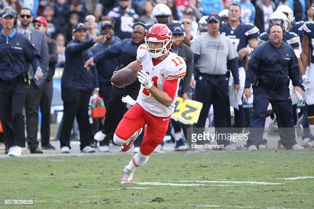 Alex Smith of Kansas City Chiefs carries the ball against the San Diego Chargers during a NFL game at Qualcomm Stadium on January 1 2017 in San Diego...