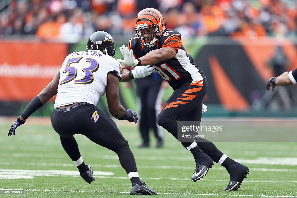 Alex Smith #81 of the Cincinnati Bengals runs with the ball during the NFL game against the Baltimore Ravens at Paul Brown Stadium on December 29, 2013 in Cincinnati, Ohio.