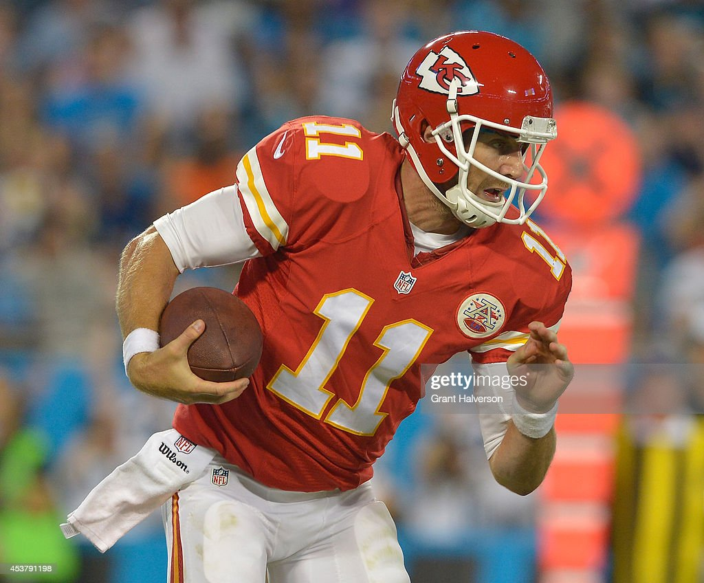 Alex Smith #11 of the Kansas City Chiefs against the Carolina Panthers during their game at Bank of America Stadium on August 17, 2014 in Charlotte, North Carolina. Carolina won 28-16.