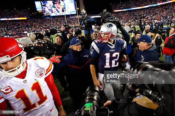 Alex Smith of the Kansas City Chiefs and Tom Brady of the New England Patriots speak while leaving the field after the AFC Divisional Playoff Game at...