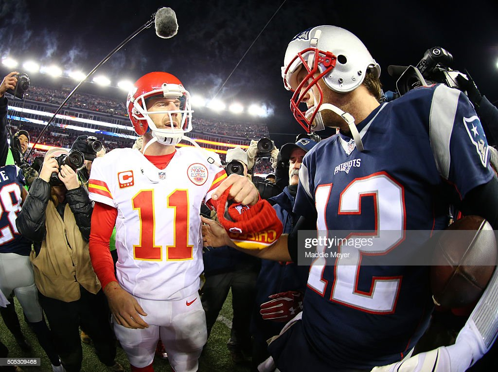 Alex Smith #11 of the Kansas City Chiefs and Tom Brady #12 of the New England Patriots speak after the AFC Divisional Playoff Game at Gillette Stadium on January 16, 2016 in Foxboro, Massachusetts. The Patriots defeated the Chiefs 27-20.