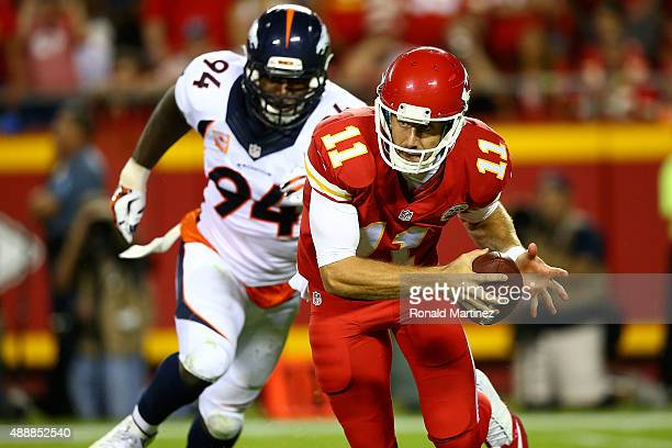 Alex Smith of the Kansas City Chiefs avoids the rush of DeMarcus Ware of the Denver Broncosduring the game at Arrowhead Stadium on September 17 2015...