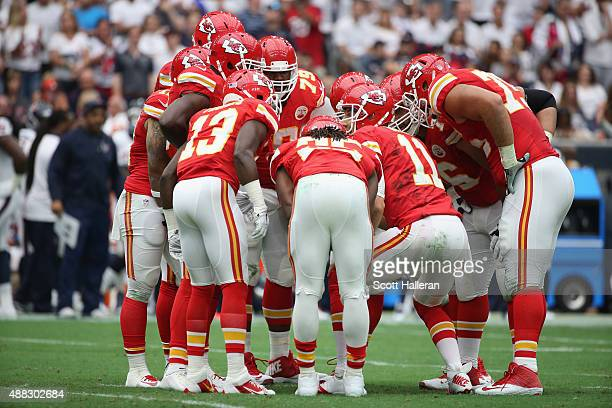 Alex Smith of the Kansas City Chiefs calls a play in the huddle during their game against the Houston Texans at NRG Stadium on September 13 2015 in...