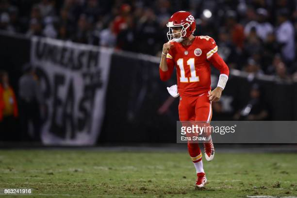 Alex Smith of the Kansas City Chiefs celebrates after a 64yard touchdown against the Oakland Raiders during their NFL game at OaklandAlameda County...