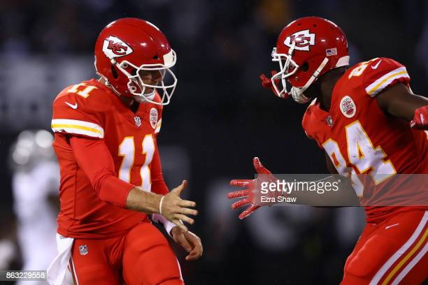Alex Smith of the Kansas City Chiefs celebrates with Demetrius Harris after a 64yard touchdown against the Oakland Raiders during their NFL game at...