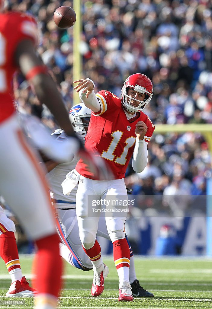 Alex Smith #11 of the Kansas City Chiefs completes a pass for a first down during NFL game action against the Buffalo Bills at Ralph Wilson Stadium on November 3, 2013 in Orchard Park, New York.