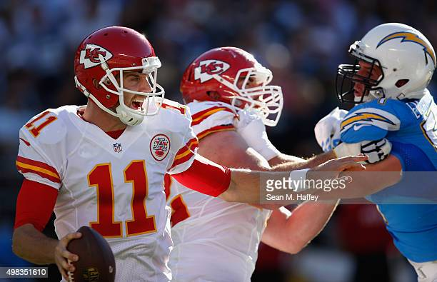 Alex Smith of the Kansas City Chiefs eludes the tackle of Kyle Emanuel of the San Diego Chargers during the first half of a game at Qualcomm Stadium...