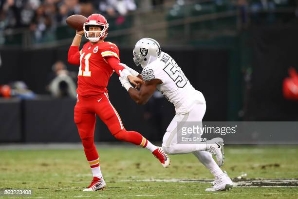 Alex Smith of the Kansas City Chiefs is pressured by Khalil Mack of the Oakland Raiders during their NFL game at OaklandAlameda County Coliseum on...
