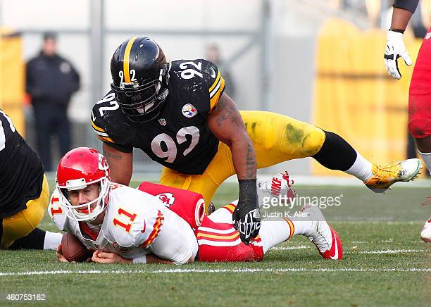 Alex Smith of the Kansas City Chiefs is tackled by James Harrison of the Pittsburgh Steelers during the third quarter at Heinz Field on December 21...