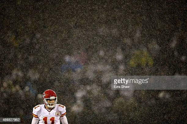 Alex Smith of the Kansas City Chiefs looks on as downpour of rain falls during the game against the Oakland Raiders at Oco Coliseum on November 20...