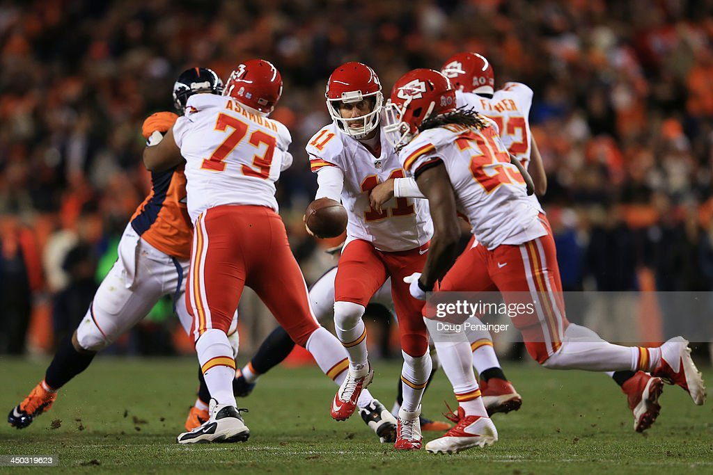 Alex Smith #11 of the Kansas City Chiefs looks to hand-off against the Denver Broncos at Sports Authority Field at Mile High on November 17, 2013 in Denver, Colorado.