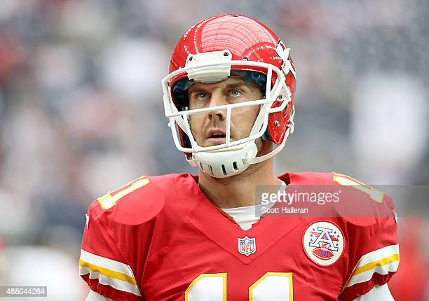 Alex Smith of the Kansas City Chiefs looks up to the scoreboard during warmup before playing against the Houston Texans in a NFL game on September 13...