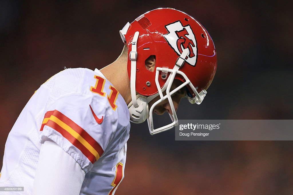 Alex Smith #11 of the Kansas City Chiefs reacts in the first half against the Denver Broncos at Sports Authority Field at Mile High on November 17, 2013 in Denver, Colorado.