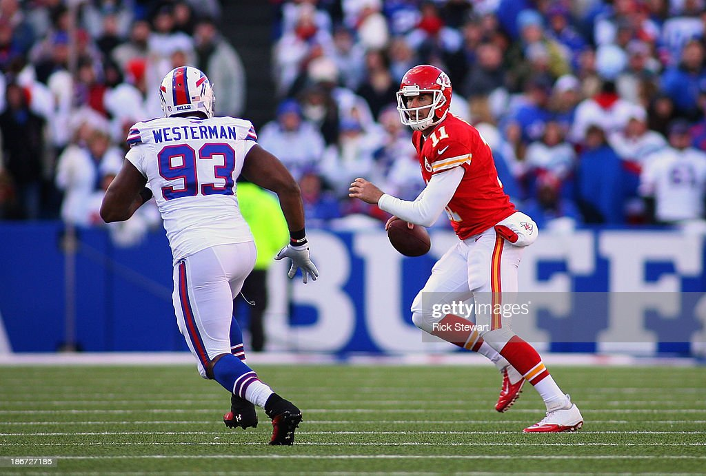 Alex Smith #11 of the Kansas City Chiefs rolls out against linebacker Jamaal Westerman #93 of the Buffalo Bills at Ralph Wilson Stadium on November 3, 2013 in Orchard Park, New York. Kansas City won 23-13.