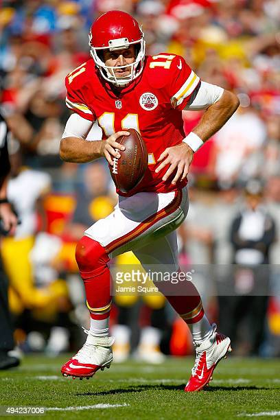 Alex Smith of the Kansas City Chiefs rolls out of the pocket at Arrowhead Stadium during the fourth quarter of the game against the Pittsburgh...