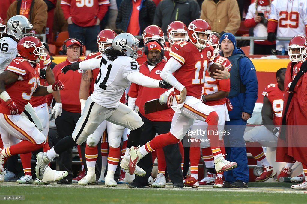 <a gi-track='captionPersonalityLinkClicked' href=/galleries/search?phrase=Alex+Smith+-+American+Football+Quarterback&family=editorial&specificpeople=4584854 ng-click='$event.stopPropagation()'>Alex Smith</a> #11 of the Kansas City Chiefs runs down the sideline beyond <a gi-track='captionPersonalityLinkClicked' href=/galleries/search?phrase=Ben+Heeney&family=editorial&specificpeople=9689082 ng-click='$event.stopPropagation()'>Ben Heeney</a> #51 of the Oakland Raiders at Arrowhead Stadium during the second quarter of the game on January 3, 2016 in Kansas City, Missouri.