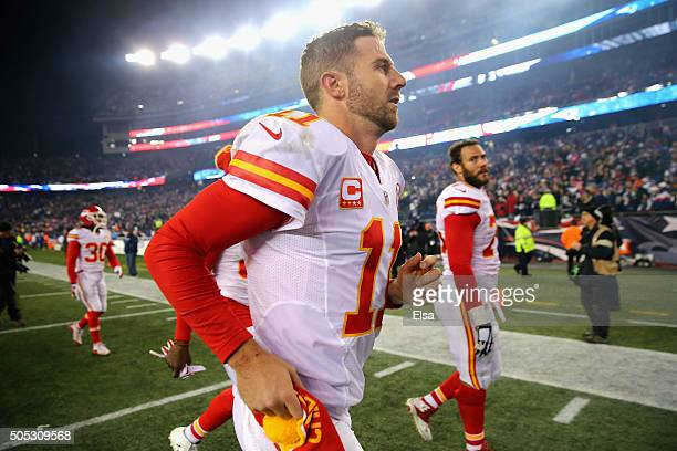 Alex Smith of the Kansas City Chiefs runs off the field after being defeated by the New England Patriots during the AFC Divisional Playoff Game at...