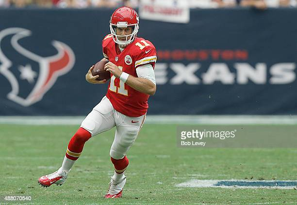 Alex Smith of the Kansas City Chiefs rushes against the Houston Texans in the third quarter in a NFL game on September 13 2015 at NRG Stadium in...
