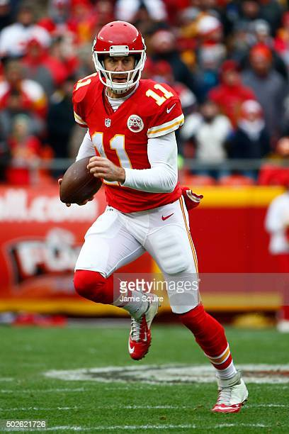 Alex Smith of the Kansas City Chiefs rushes the ball at Arrowhead Stadium during the first quarter of the game on December 27 2015 in Kansas City...