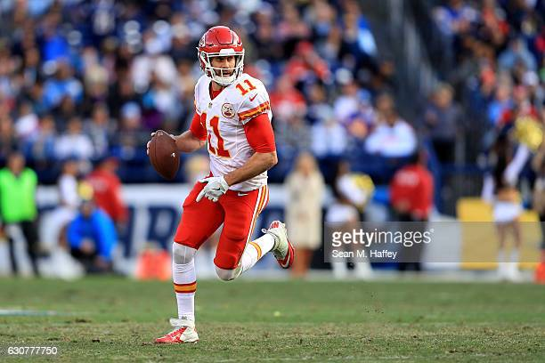 Alex Smith of the Kansas City Chiefs scrambles from the pocket during the second half of a game against the San Diego Chargers at Qualcomm Stadium on...