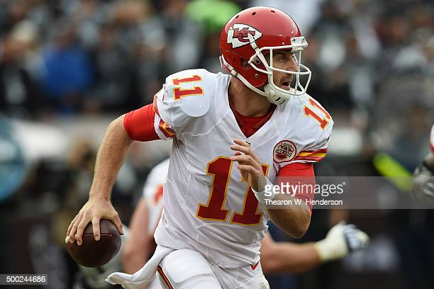 Alex Smith of the Kansas City Chiefs scrambles with the ball against the Oakland Raiders during their NFL game at Oco Coliseum on December 6 2015 in...