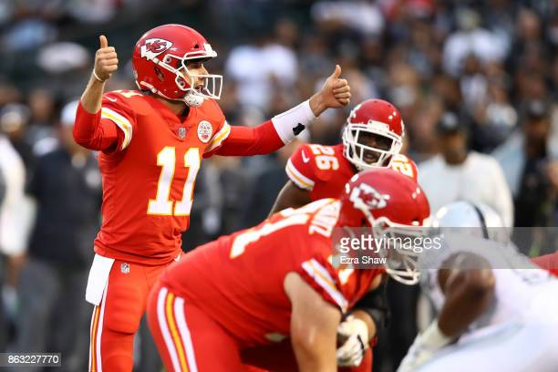 Alex Smith of the Kansas City Chiefs signals during their NFL game against the Oakland Raiders at OaklandAlameda County Coliseum on October 19 2017...