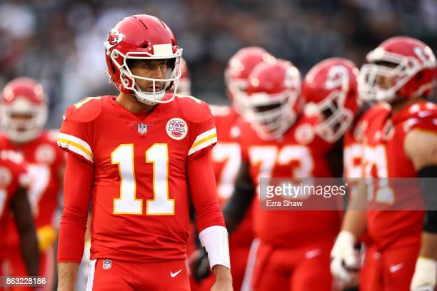 Alex Smith of the Kansas City Chiefs stands on the field during their NFL game against the Oakland Raiders at OaklandAlameda County Coliseum on...