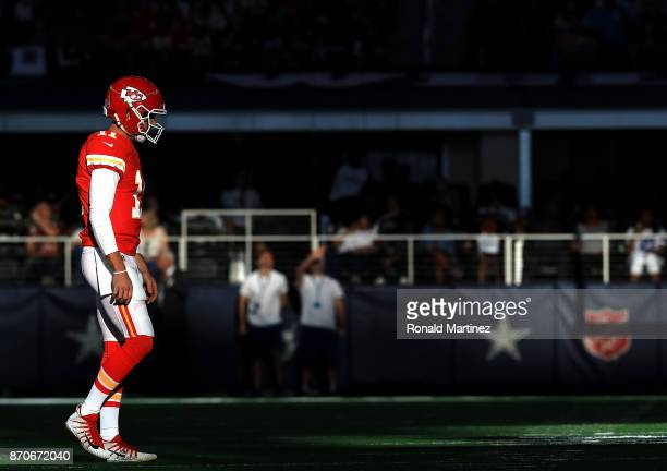 Alex Smith of the Kansas City Chiefs walks onto the field during the second quarter against the Dallas Cowboys at ATT Stadium on November 5 2017 in...