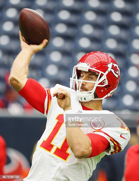 Alex Smith of the Kansas City Chiefs works out on the field prior to the start of their game against the Houston Texans at NRG Stadium on September...