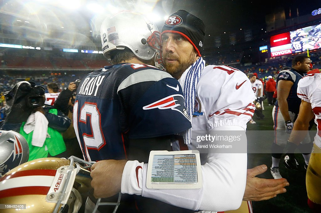 Alex Smith #11 of the San Francisco 49ers greets <a gi-track='captionPersonalityLinkClicked' href=/galleries/search?phrase=Tom+Brady+-+American+Football+Quarterback&family=editorial&specificpeople=201737 ng-click='$event.stopPropagation()'>Tom Brady</a> #12 of the New England Patriots following the game at Gillette Stadium on December 17, 2012 in Foxboro, Massachusetts.