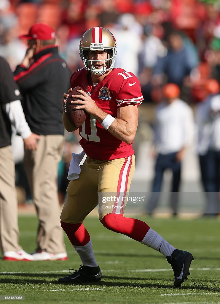 Alex Smith #11 of the San Francisco 49ers warms up before their game against the Miami Dolphins at Candlestick Park on December 9, 2012 in San Francisco, California.