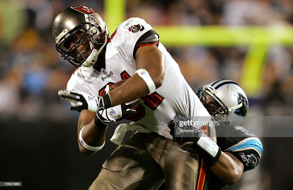 Alex Smith #81 of the Tampa Bay Buccaneers is tackled by Chris Draft #52 of the Carolina Panthers on November 13, 2006 at Bank of America Stadium in Charlotte, North Carolina.
