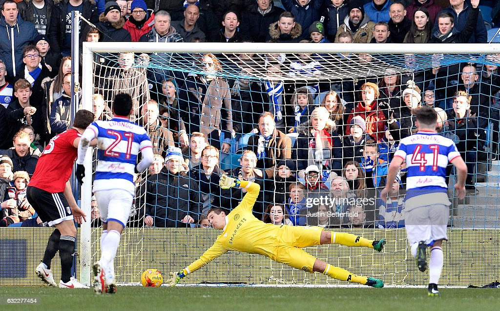 Alex Smithies of Queens Park Rangers (C) saves Chris Martin of Fulham FC (L) penalty during the Sky Bet Championship match between Queens Park Rangers and Fulham at Loftus Road on January 21, 2017 in London, England.