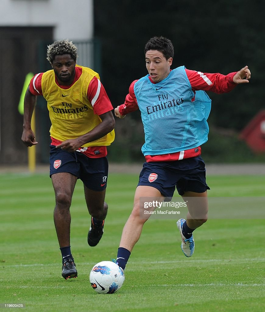 <a gi-track='captionPersonalityLinkClicked' href=/galleries/search?phrase=Alex+Song&family=editorial&specificpeople=652067 ng-click='$event.stopPropagation()'>Alex Song</a> and Samoir Nasri (R) of Arsenal compete for the ball during a training session as part of the club's pre-season preparations on July 27, 2011 in Hennef, North Rhine-Westphalia.