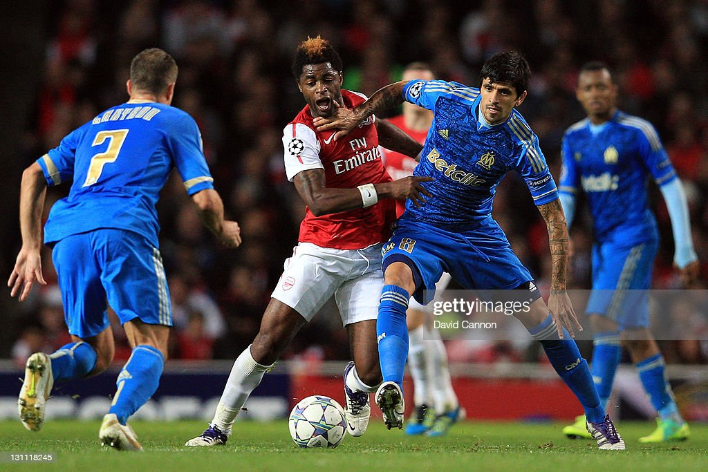 Alex Song of Arsenal battles for the ball with Lucho Gonzalez of Olympique de Marseille during the UEFA Champions League Group F match between...