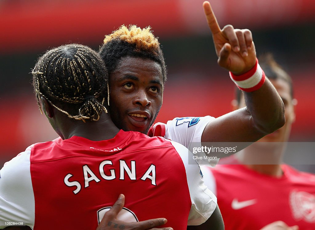 <a gi-track='captionPersonalityLinkClicked' href=/galleries/search?phrase=Alex+Song&family=editorial&specificpeople=652067 ng-click='$event.stopPropagation()'>Alex Song</a> of Arsenal celebrates his goal with team mate Bacary Sagna during the Barclays Premier League match between Arsenal and Bolton Wanderers at Emirates Stadium on September 24, 2011 in London, England.