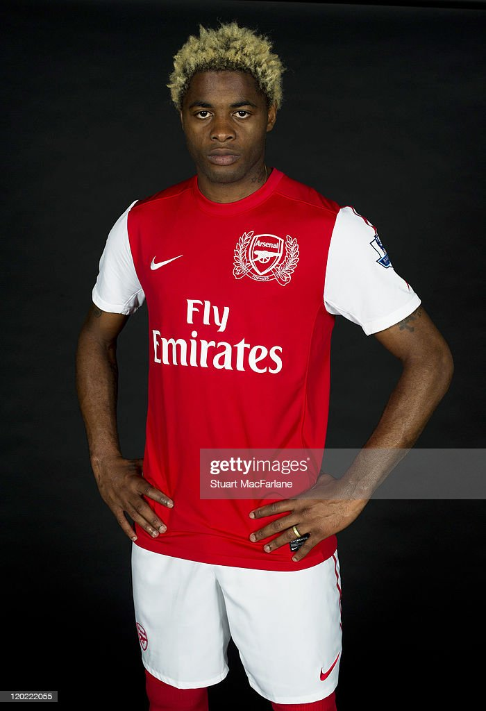 <a gi-track='captionPersonalityLinkClicked' href=/galleries/search?phrase=Alex+Song&family=editorial&specificpeople=652067 ng-click='$event.stopPropagation()'>Alex Song</a> of Arsenal FC poses in the Arsenal home kit for the 2011/2012 season at their London Colney training ground on April 8, 2011 in St. Albans, England.