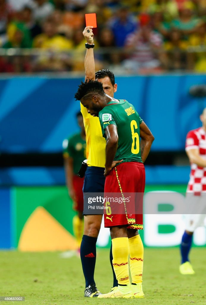 <a gi-track='captionPersonalityLinkClicked' href=/galleries/search?phrase=Alex+Song&family=editorial&specificpeople=652067 ng-click='$event.stopPropagation()'>Alex Song</a> of Cameroon is shown a red card by referee <a gi-track='captionPersonalityLinkClicked' href=/galleries/search?phrase=Pedro+Proenca&family=editorial&specificpeople=5701749 ng-click='$event.stopPropagation()'>Pedro Proenca</a> during the 2014 FIFA World Cup Brazil Group A match between Cameroon and Croatia at Arena Amazonia on June 18, 2014 in Manaus, Brazil.