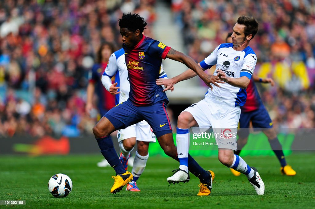 <a gi-track='captionPersonalityLinkClicked' href=/galleries/search?phrase=Alex+Song&family=editorial&specificpeople=652067 ng-click='$event.stopPropagation()'>Alex Song</a> of FC Barcelona duels for the ball with Borja Fernandez of Getafe CF during the La Liga match between FC Barcelona and Getafe CF at Camp Nou on February 10, 2013 in Barcelona, Spain.