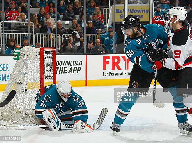 Alex Stalock and Brent Burns of the San Jose Sharks protect the net after the shot against Martin Havlat of the New Jersey Devils during an NHL game...