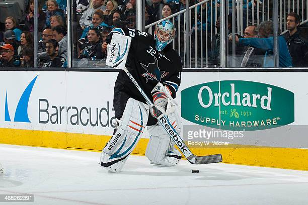 Alex Stalock of the San Jose Sharks controls the puck against the Winnipeg Jets at SAP Center on January 23 2014 in San Jose California