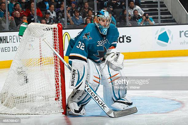 Alex Stalock of the San Jose Sharks defends the net against the Los Angeles Kings at SAP Center on January 27 2014 in San Jose California