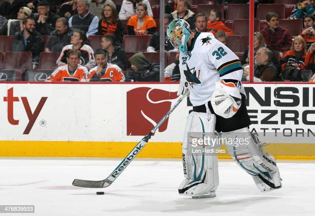 Alex Stalock of the San Jose Sharks handles the puck against the Philadelphia Flyers on February 27 2014 at the Wells Fargo Center in Philadelphia...